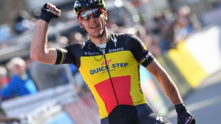 Belgian cyclist Philippe Gilbert of Quick-Step Floors celebrates as he crosses the finish line to win the first stage of the Driedaagse De Panne - Koksijde cycling race