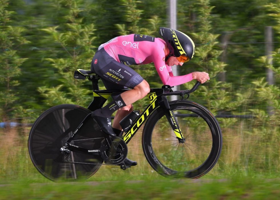 Britain's rider of team Mitchelton-Scott Simon Yates celebrates the pink jersey of the overall leader on the podium after winning the 15th stage between Tolmezzo and Sappada of the 101st Giro d'Italia